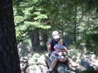 Being held by 'Uncle' Dave on Mt Elden